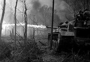 Flame tanks of the 1st Tank Battalion attack No-name Village, in the Quang Ngai province of Vietnam, during Operation Doser.