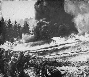 French soldiers make a gas and flame attack on German trenches in Flanders, Belgium, during WWI.