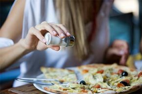 Salt on your pizza? Why not? Salt enhances the natural flavors  of just about anything.