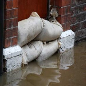 Sandbagging can help prevent water from entering a house.