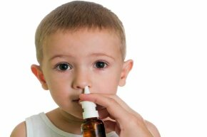 The FluMist nasal spray vaccine, which is sometimes given to children,  does contain a live weakened virus but it could only cause an infection in the nose, nowhere else.