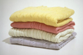 Properly folded sweaters will keep their shape and form better than those stored on hangers.
