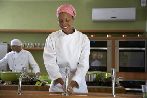 This cooking school student has learned the importance of hand-washing before preparing food.