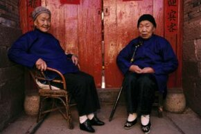 "Two elderly women in Tonghai, China wear tiny ""lotus shoes"" on their bound feet. Foot binding was a common practice in China for more than 1,000 years before it was outlawed in 1912. See more pictures of China."