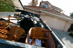A Dumpster is filled with furniture and personal property in front of a vacant home in October 2007 in Antioch, Calif. California ranks third behind Ohio and Michigan ­in foreclosures.