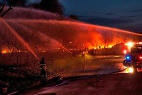 Firefighters battle a brush fire