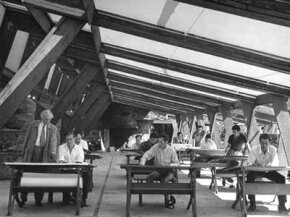 Wright advises members of the Taliesin Fellowship, hard at work at their drafting boards.