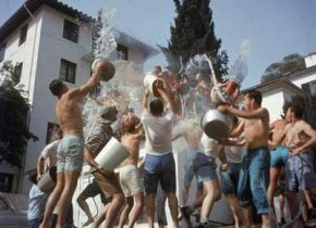 The Sigma Pi and Phi Kappa Sigma fraternities have a water fight on the UCLA (University of California at Los Angeles) campus, Los Angeles, California, April 3, 1957. See more pictures of college life.