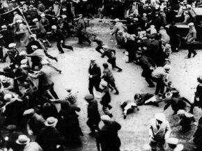 Violent strikes, like this one in Passaic, New Jersey, in 1926, led to new federal labor laws. Depending on your view, the government either protected American workers or leveraged unrest to gain control over business.