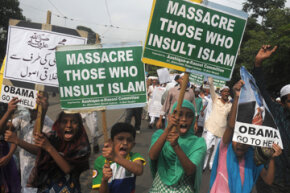 "Indian Muslim children shout anti-US slogans as they participate in a protest meeting against the film ""Innocence of Muslims."" In many countries, it is against the law to criticize or ""blaspheme"" a particular religion or religions in general."
