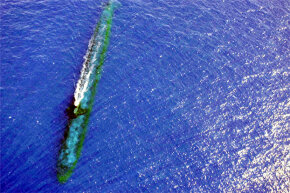 The Los Angeles Class Attack submarine USS Chicago (SSN 721) completes a training maneuver off the coast of Malaysia in July 2001. Kind of makes you realizes how friction could be a very formidable force for a beast like that.