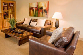 Consider scale when furnishing a room. With a large sofa and chair, you want a chunky coffee table that matches the other furniture's girth.