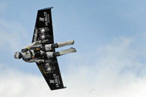 Swiss professional pilot Yves Rossy, better known as FusionMan, the world's first man to fly with fitted jet fuel powered wings strapped to his back, flies during his first official demonstration on May 14, 2008, over Bex, Switzerland.
