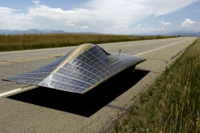 No need for a solar-paneled car if we come up with roads that can wirelessly provide power to an electric car.