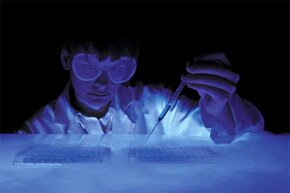 A scientist cryogenically stores samples of DNA.