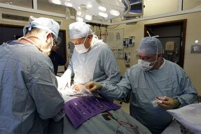 Consultant surgeon Andrew Ready and his team conduct a live donor kidney transplant at the Queen Elizabeth Hospital in Birmingham, England. Organs have a short shelf-life but designing custom implants could increase their lifespan.