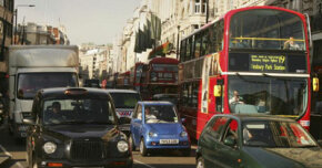 The G-Wiz huddles among taxi cabs, delivery trucks and hulking double-decker buses in London, England.­