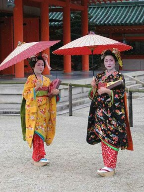 Two apprentice geisha outside Heian Jingu shrine in Kyoto