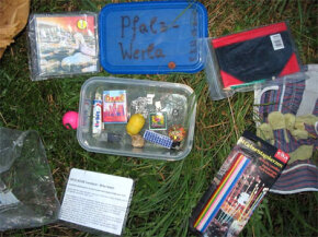 Many geocaches, like this one found in Germany, ­contain a variety of items, including toys and CDs.