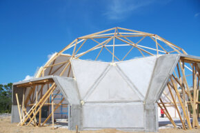 Dome homes may have nontraditional designs, but they can still incorporate traditional construction materials, such as wood beams and concrete.
