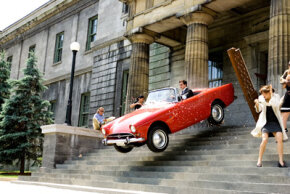 Steve Carell flies in one of the classic sports cars driven in the movie.