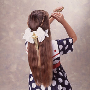 This simple bow is easy to make and sets off a roped hairdo.