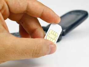 Swapping out the SIM card in your phone may let you use your own phone when you travel -- depending on where you go. See more pictures of cell phones.