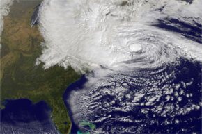 In this NASA satellite image, Hurricane Sandy churns off the East Coast on Oct. 29, 2012, in the Atlantic Ocean. No doubt the hurricane that made landfall as a cyclone left immense destruction in its wake, but was it related to global warming? See more pictures of Hurricane Sandy.