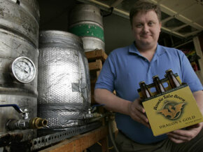 Brewer Craig Belser displays his gluten-free beer.