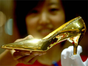 Forget those ruby red slippers, Dorothy. This gold shoe, made in China and yours for the low price of $41,000, will take you a lot farther than Kansas.