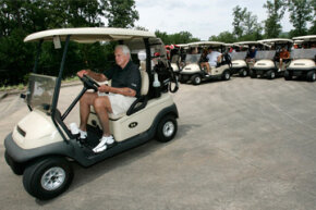 Veteran sportscaster Pat Summerall drives a golf cart before playing in the celebrity match that bears his name at Chenal Country Club in Little Rock, Ark.