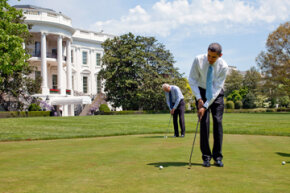 U.S. President Barack Obama and Vice President Joe Biden practice on the White House putting green.