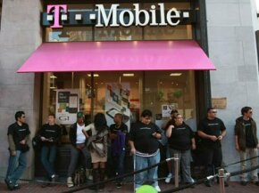 Customers wait in line to purchase a new HTC G1 at a T-Mobile store in San Francisco.