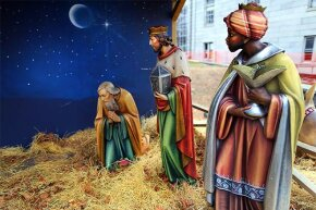 Two wise men look at Joseph kneeling, as Mary and Jesus are no longer there. They were stolen along with two other figures from a Nativity display next to Quincy City Hall, Boston in 2013.