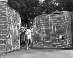 Fans leave the famous front gates of Graceland in the 1960s.