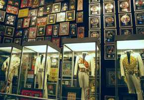 Elvis' famous jumpsuits and gold records are on display in the racquetball building.