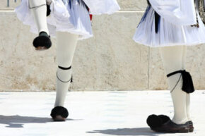 The uniform for the Evzones, the Greek presidential guard, includes a white pleated foustanella and pointed shoes called tsarouhia that are topped with pompons.