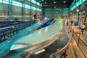 A 164-foot (50-meter) wind turbine blade comes to life in a Cape Town, South Africa, factory.