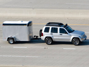 Towing will most certainly put a dent in your car's MPG, but there are ways to improve fuel economy even when towing a heavy load.