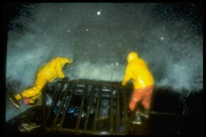 Crab fishermen who haul in pots face furious and frigid waves.