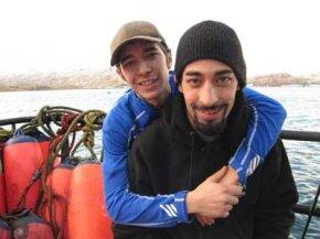 A greenhorn embrace -- deckhand Jake Harris and greenhorn Joshua Harris, onboard an Alaskan king crab boat