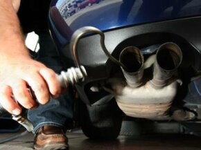 Where can you find out your vehicle's greenhouse gas score?