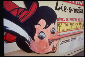 ­A Brazilian environmental group protests alleged greenwashing with a Pinocchio Lie-O-Meter.
