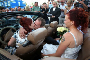 Even unusual weddings, like this mass Rockabilly drive-in wedding in Sweden in 2008, feature old traditions. See more pictures of kissing.