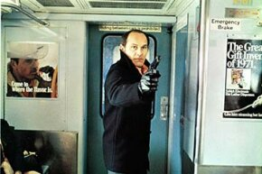 Tony Lo Bianco points a gun on a subway in a scene from the 1971 film 'The French Connection.'  The movie was shot guerilla-style all over New York.