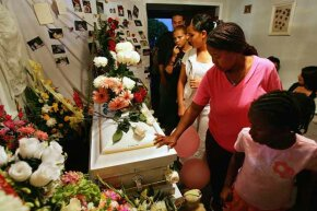 baby casket, mourners