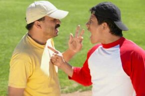 Two people arguing on field