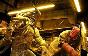 Hellboy (Ron Perlman - right) does battle with the unstoppable creature Sammael (Brian Steele - left).