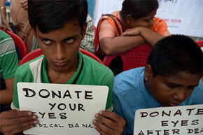 Visually challenged youth in India hold posters during a campaign to create awareness about eye donation in Kolkata on Aug. 27, 2014.