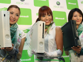 Models show, from left, the Xbox 360 Arcade, the new 60-gigabyte Xbox 360 and the Xbox Elite during a Microsoft press conference in Tokyo Monday, Sept. 1, 2008.